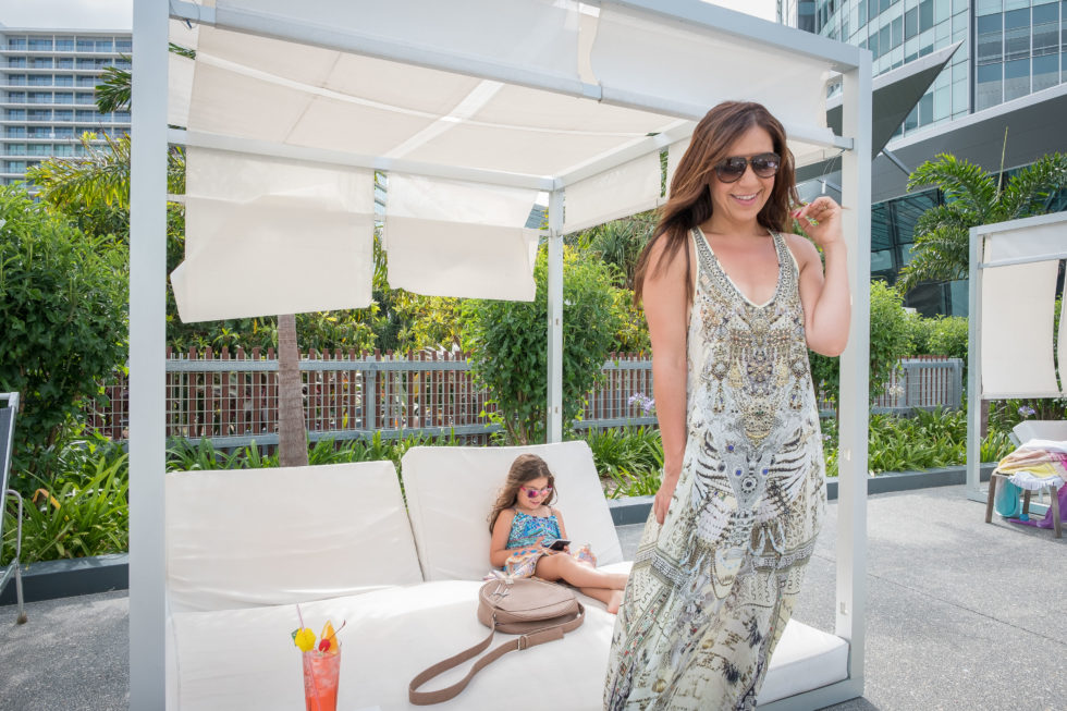 Poolside Cabanas and Cocktails (wearing Camilla(